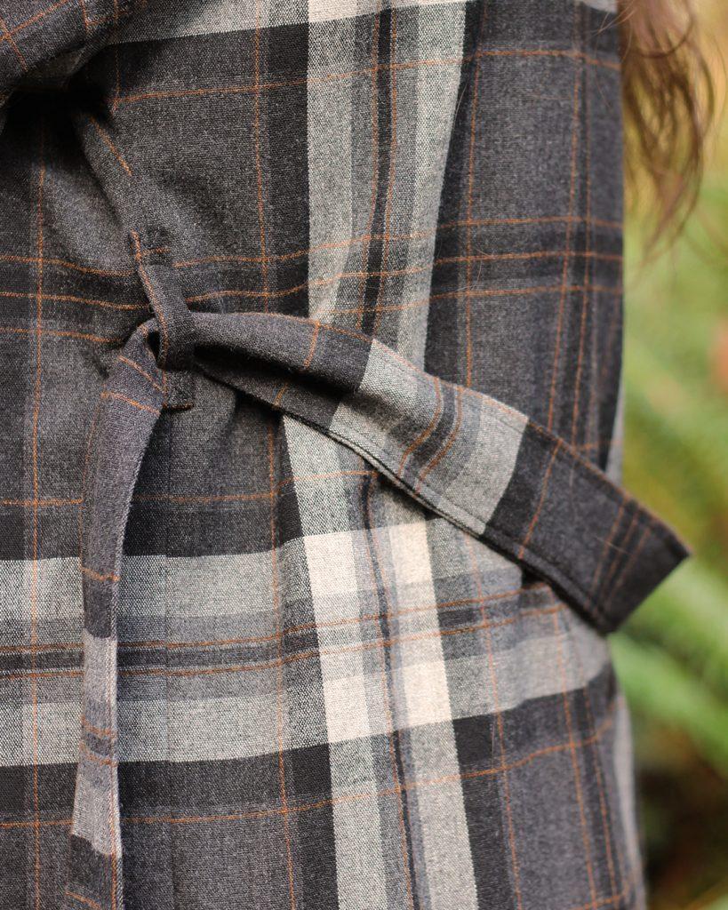 Close up of belt loops and self fabric belt.