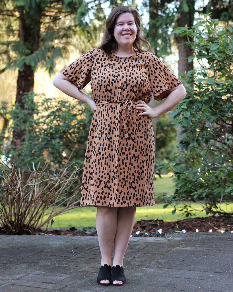 Helen models her Ashton dress hack with her hands on her hips.