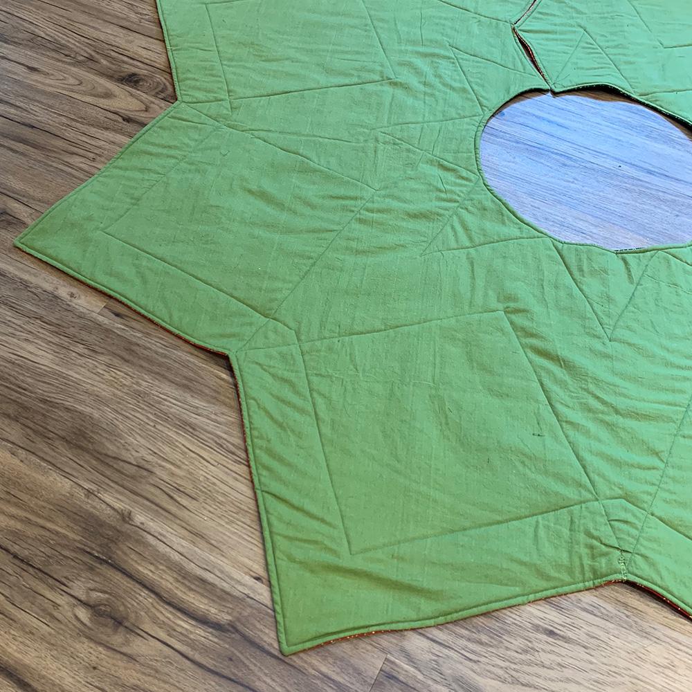 Christmas Tree Skirt back in green cotton.