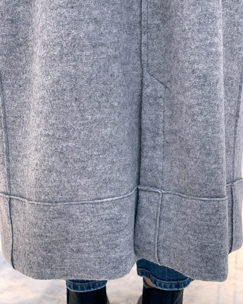 Lengthened Pona Jacket with kick pleat detail, made in a gray boiled wool.
