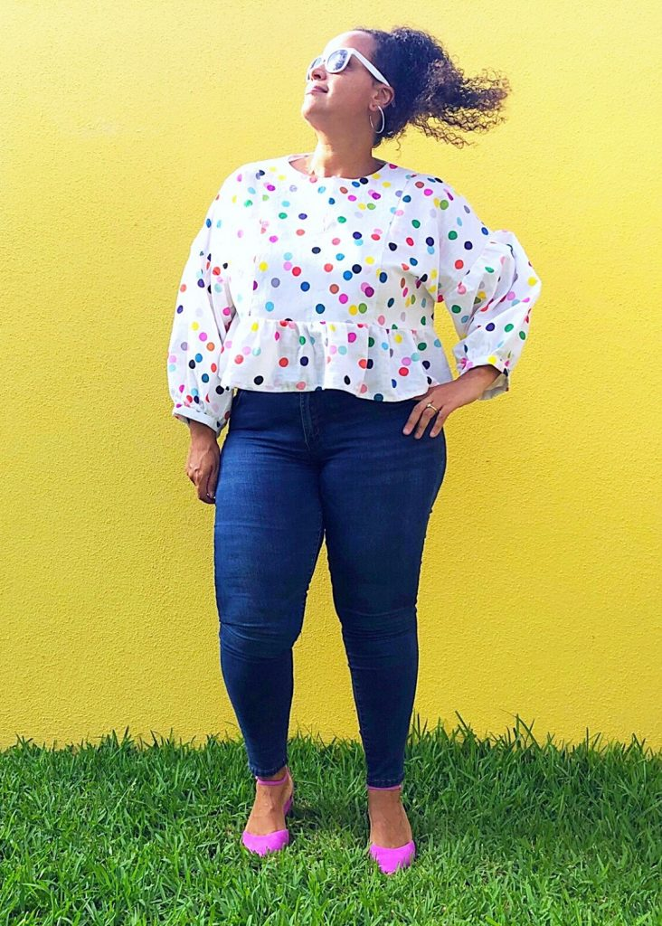 Flavia showing off the March Top in a bright polka dot print.