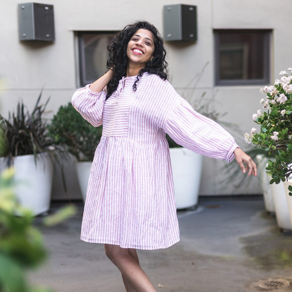 Swetha wearing a March Dress in a red striped linen fabric.