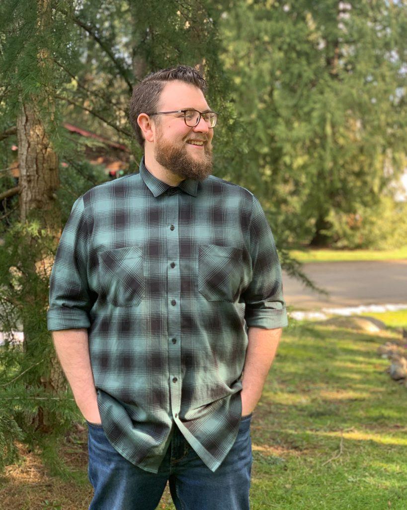 Sam models a men's button up shirt pattern.