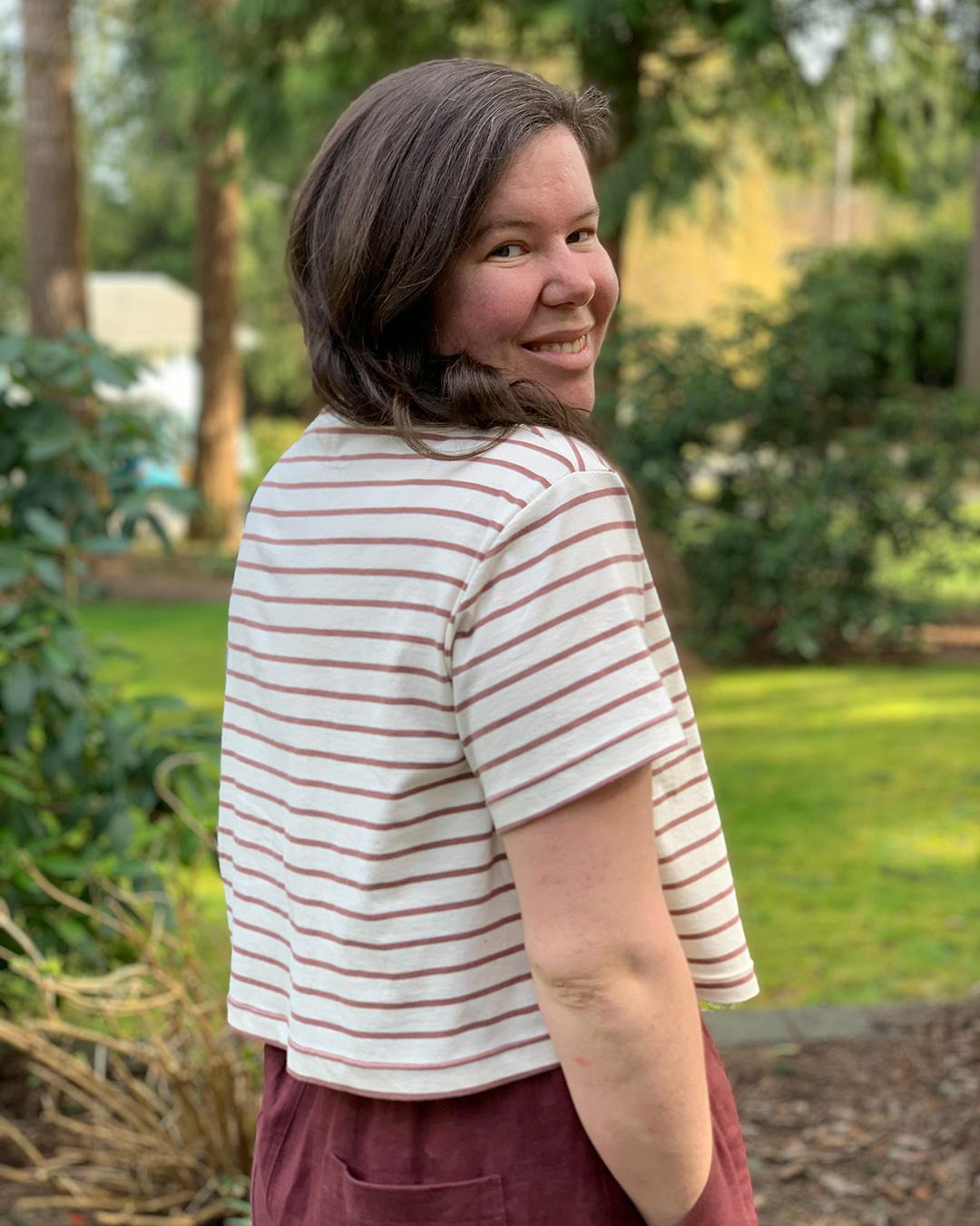 Helen looks over her shoulder wearing her cropped Jackson Tee.