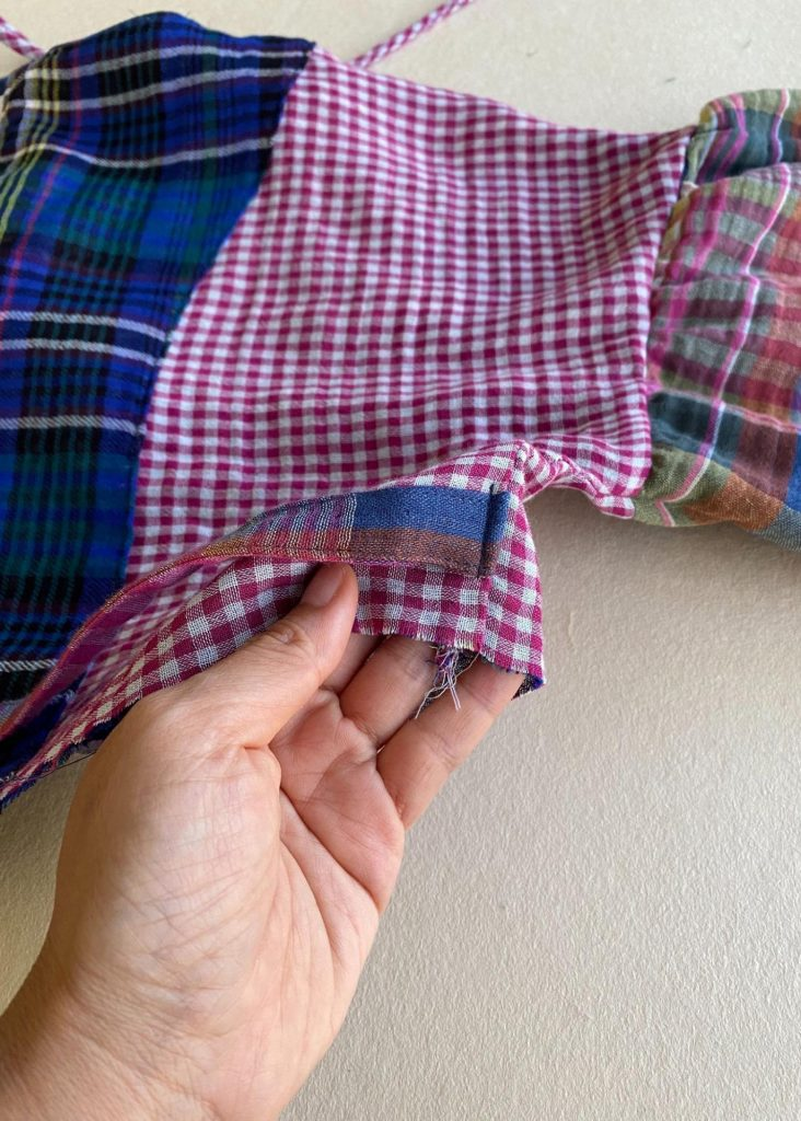 Attaching the waist ties.