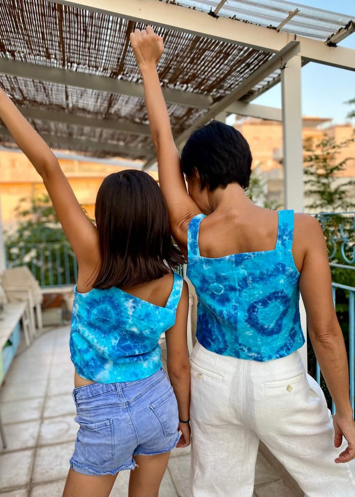 Geri and her daughter model their matching Reynolds Tops, which feature a variety of tie-dye designs.