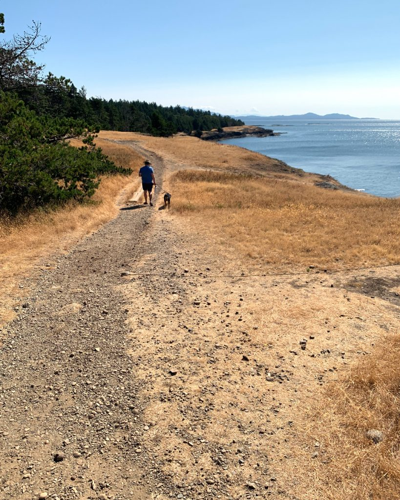 Sam and Emma walking in Helliwell Park on Hornby Island
