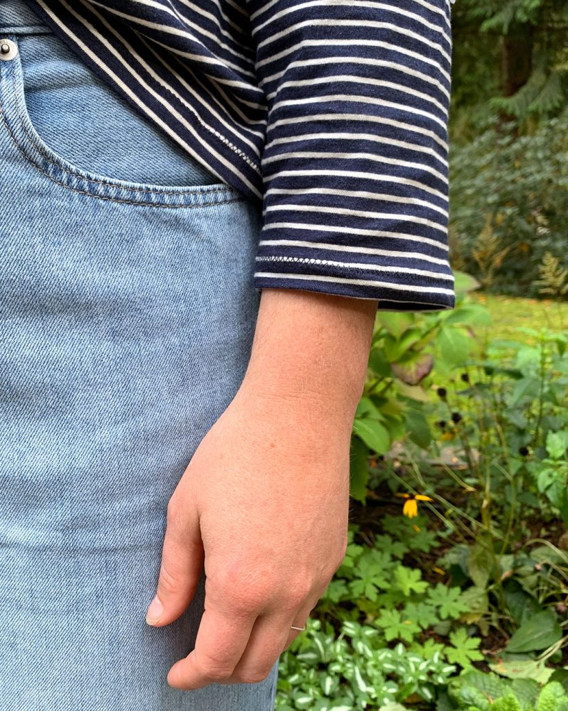 Close up of sleeve and t shirt hem, done in a zig zag stitch.